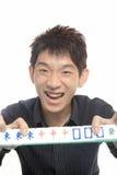 Gioco cinese Mahjong dell'uomo Fotografia Stock