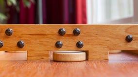 Gioco da tavolo di legno olandese tipico - Sjoelen Fotografia Stock