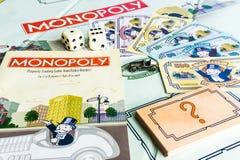 Gioco da tavolo di monopolio - prossimo con istruzione del gioco immagini stock libere da diritti