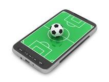 Gioco del calcio - sfera di calcio e telefono mobile Fotografia Stock Libera da Diritti