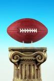 Gioco del calcio sul basamento della colonna Fotografia Stock
