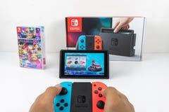 Gioco del Mario Kart Deluxe 8 in commutatore di Nintendo immagine stock libera da diritti