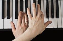 Gioco del piano. Immagini Stock