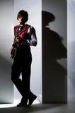 Gioco del sassofono Fotografia Stock