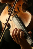 Gioco del violino Immagini Stock