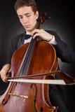 Gioco del violoncello Fotografia Stock