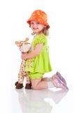 Gioco della neonata con il giocattolo Fotografia Stock