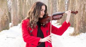 Gioco della ragazza violine Fotografie Stock