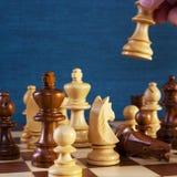 Gioco di scacchi che fa un quadrato di movimento copiare spazio Immagini Stock