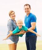 Gioco felice della famiglia Fotografia Stock