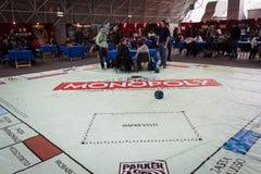 Gioco gigante di monopolio alla convenzione di Festival del Fumetto a Milano, Italia Fotografia Stock