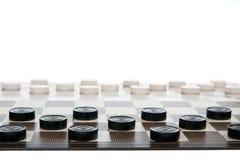 Gioco in ispettori - campo e chesspieces Fotografia Stock