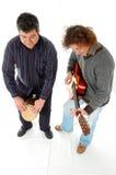 Gioco jambe e della chitarra Fotografia Stock