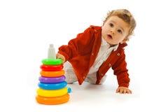 Gioco sveglio del neonato Fotografia Stock