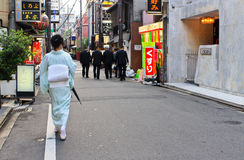 Gion, Kyoto. A woman dressed in traditional kimono walks around the district of Gion in Kyoto. Gion is Kyoto`s most famous entertainment district. It`s also Royalty Free Stock Images