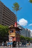 Gion Matsuri Festival, the most famous festivals in Japan. Participants in traditional clothing pulling a highly decorated huge float in the parade royalty free stock image