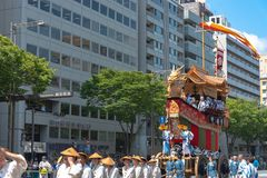 Gion Matsuri Festival, the most famous festivals in Japan. Participants in traditional clothing pulling a highly decorated huge float in the parade stock photos
