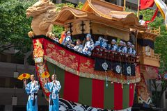 Gion Matsuri Festival, the most famous festivals in Japan. Participants in traditional clothing pulling a highly decorated huge float in the parade royalty free stock photos