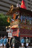 Gion Matsuri Festival, the most famous festivals in Japan. Participants in traditional clothing pulling a highly decorated huge float in the parade royalty free stock images