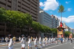 Gion Matsuri Festival, the most famous festivals in Japan. Participants in traditional clothing pulling a highly decorated huge float in the parade stock photography