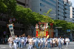 Gion Matsuri Festival, the most famous festivals in Japan. Participants in traditional clothing pulling a highly decorated huge float in the parade stock image