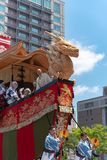 Gion Matsuri Festival, the most famous festivals in Japan. Participants in traditional clothing pulling a highly decorated huge float in the parade stock photo