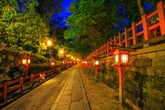 Gion Shrine by night. Illuminated path at night from the red lanterns leading from Yasaka Shrine to the Gion weeping cherry tree in Maruyama Park. Gion Shrine is Royalty Free Stock Photo