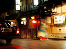 Gion story. A characteristic aspect from Gion-geisha ward.The geisha-always in hurry,a Taxi car,wooden houses,night and lights.....a piece of Japan........All Royalty Free Stock Photos