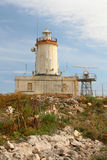 White tower lighthouse and radar Royalty Free Stock Image