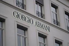 Giorgio Armani tecken utanför ett lager Fotografering för Bildbyråer