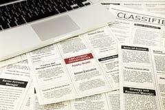 Giornale con le pubblicità e gli annunci dei classifieds Fotografia Stock