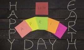 Giornata per la Terra 22 aprile felice, saluto del segno del messaggio sugli autoadesivi Fotografia Stock Libera da Diritti