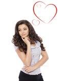 Giorno dei biglietti di S. Valentino. Bella donna con il segno del cuore Fotografia Stock Libera da Diritti