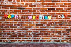Giorno delle nozze felice dell'iscrizione dalle diverse lettere Fotografia Stock Libera da Diritti