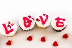 Giorno di biglietti di S. Valentino - bigné che compitano AMORE Immagine Stock Libera da Diritti