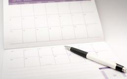 Giorno di eventi del punto di penna sul calendario fotografia stock libera da diritti