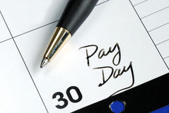 Giorno di paga del mese Immagine Stock