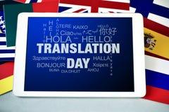 Giorno di traduzione del testo in un computer della compressa Fotografie Stock