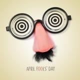 Giorno falso dei pesci d'aprile del testo e degli occhiali, con un retro effetto Immagine Stock