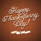 Giorno felice di ringraziamento Calligrafia di congratulazione su fondo di legno Immagini Stock Libere da Diritti
