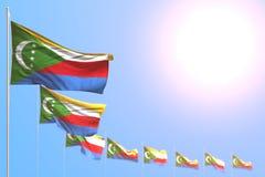 Giorno piacevole dell'illustrazione della bandiera 3d - molte bandiere delle Comore hanno disposto diagonale con il fuoco seletti illustrazione vettoriale