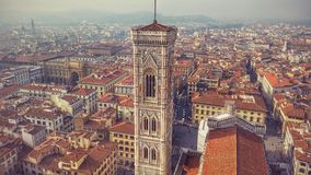 Giotto's Bell Tower in Florence Italy. View from the church duomo with red rooftops Stock Photo