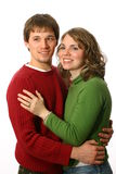 Giovane abbraccio delle coppie Immagini Stock