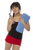 Giovane acqua asiatica della donna su bianco Immagine Stock