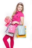 Giovane acquisto sorridente della donna Fotografie Stock Libere da Diritti