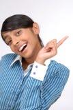Giovane adolescente che mostra su qualcosa dal afinger Fotografie Stock Libere da Diritti