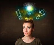 Giovane adolescente preety con la lampadina disegnata a mano Fotografia Stock