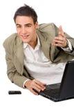 Giovane adulto con il telefono delle cellule e del computer portatile Fotografia Stock Libera da Diritti