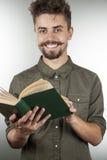 Giovane allegro con un libro Fotografie Stock