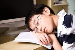 Giovane allievo addormentato Fotografia Stock